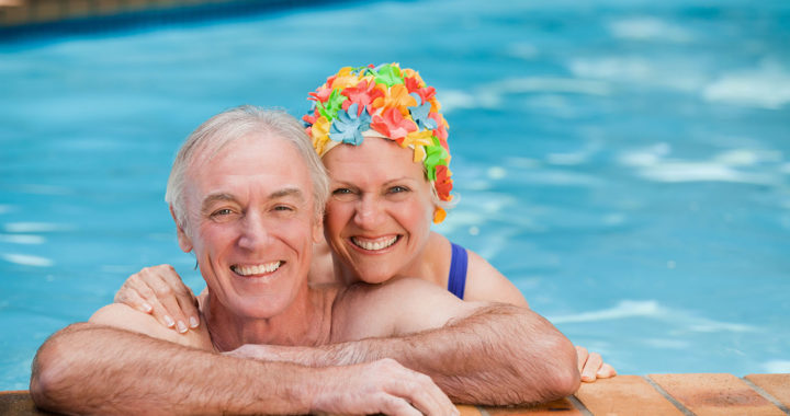 Happy mature couple in the swimming pool gambia